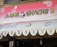 A-One Snacks, DHA Comm Karachi Logo