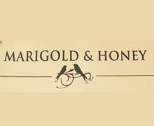 Marigold and Honey Cafe, Zamzama Karachi Logo